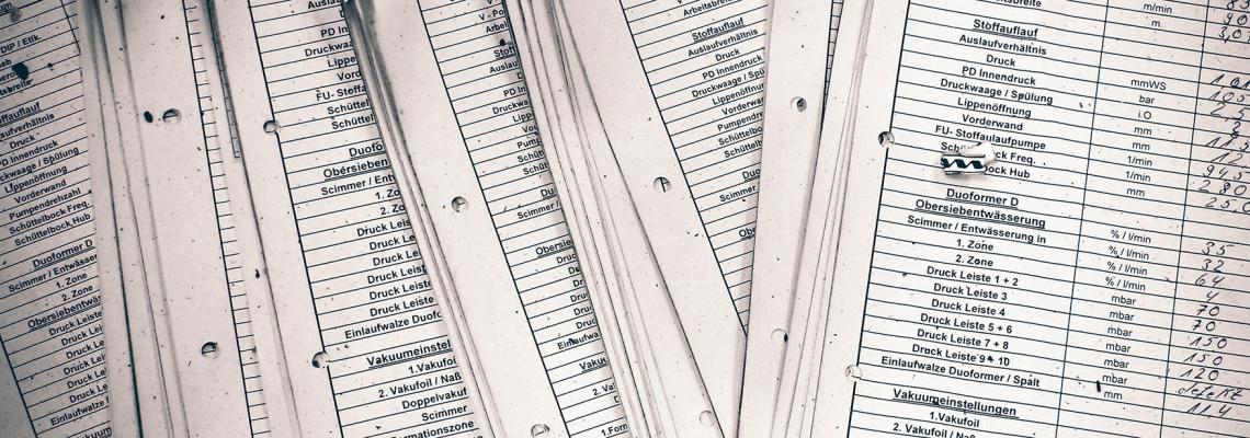 stack of white lists on paper