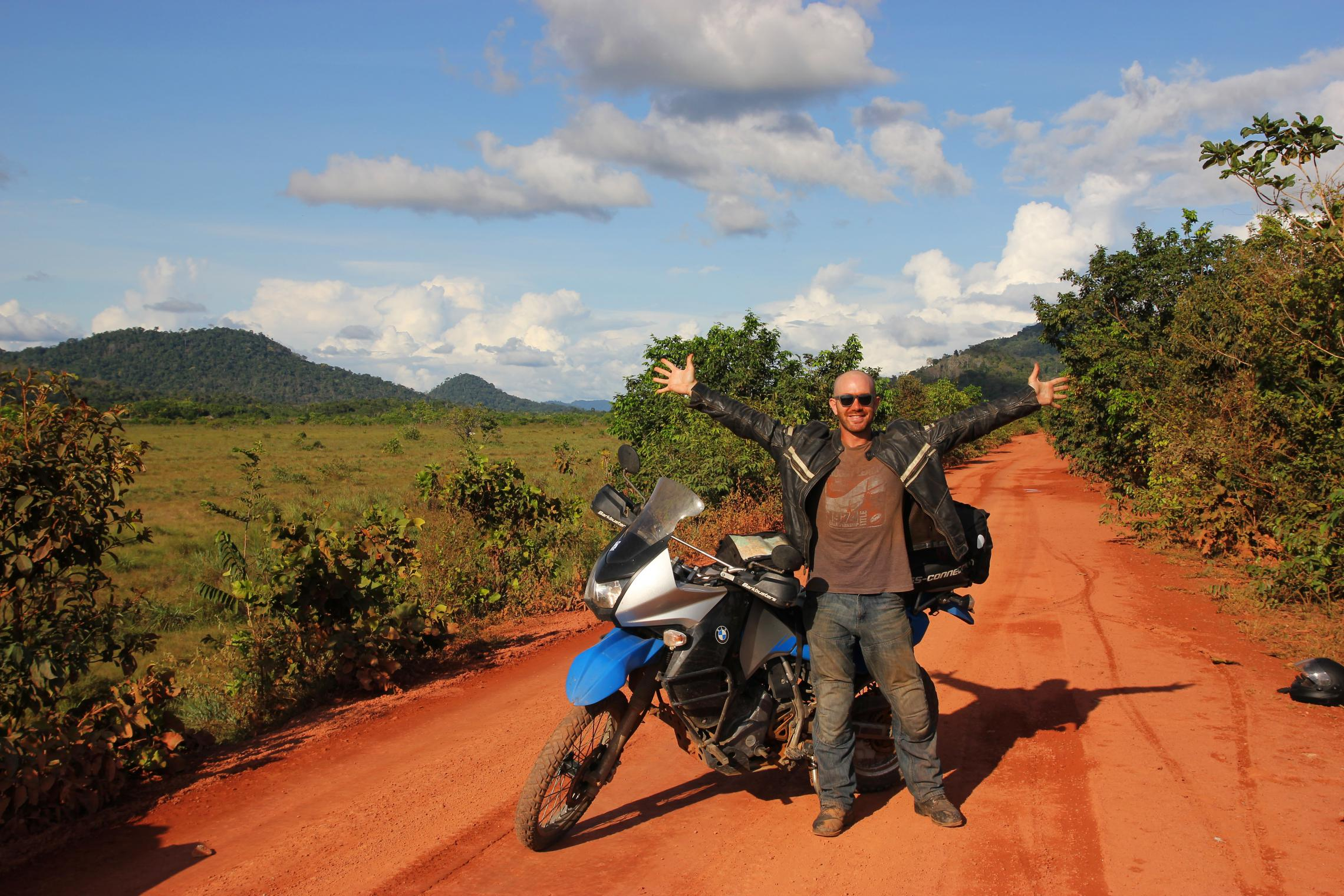 10,000 miles - The road to Annai, Guyana -- This dirt road is actually the big international highway through the Guyanese interior. It was still fun and games before we entered the rainforest.